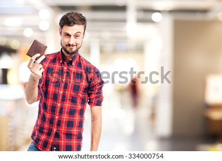 happy young man with wallet - stock photo