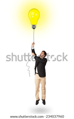 Happy young man woman holding a light bulb balloon - stock photo