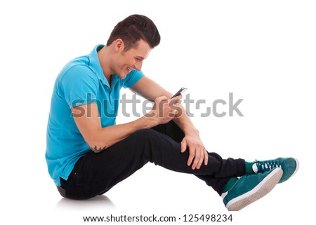 Happy young man writes a message and on a white background - stock photo
