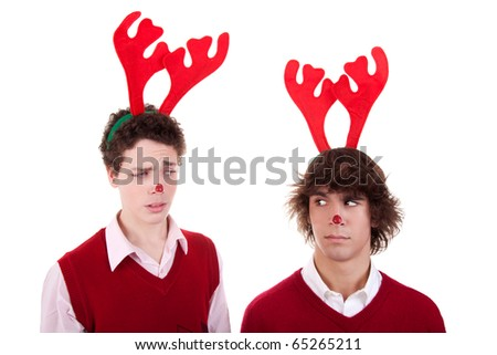 happy young men wearing reindeer horns, admired, on white, studio shot - stock photo