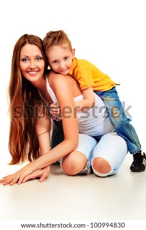 Happy young mother and her son posing together. Isolated over white. - stock photo