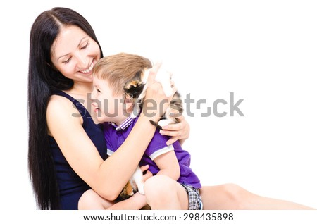 Happy young mother and son together with kittens isolated on white background - stock photo