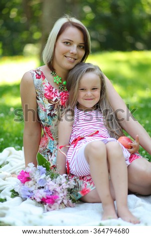 happy young mother with girl in park - stock photo