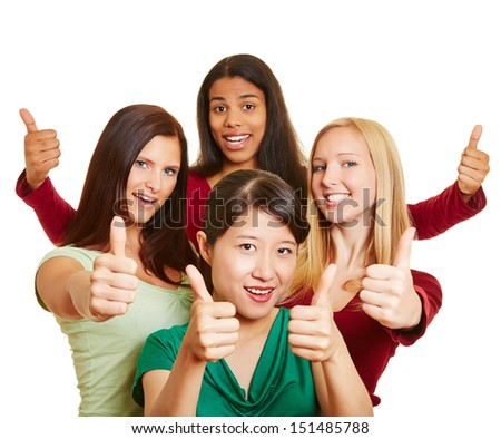 Happy young multiracial group of women holding their thumbs up