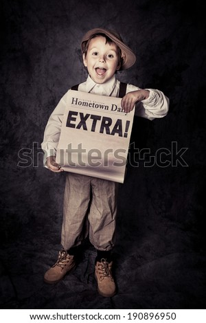 Happy young newsboy holds out a newspaper with copy space for Headline, grainy - stock photo