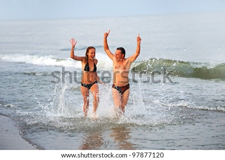 Happy young pair at the seaside