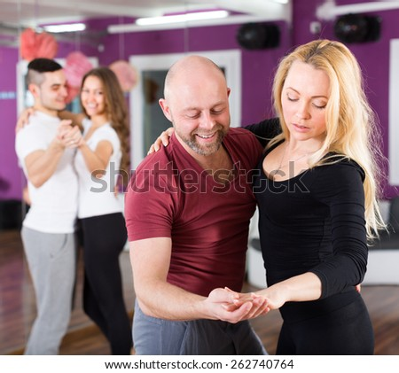 Happy young people having dancing class and relaxing indoors - stock photo