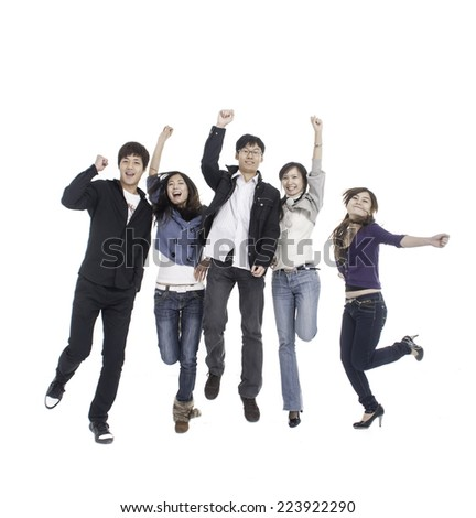 happy young people jumping - stock photo