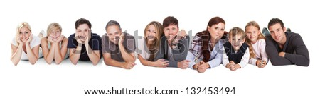 Happy young people lying on white background - stock photo