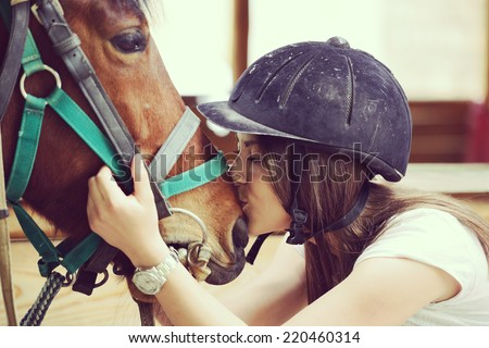 Happy young people on countryside with horse for riding - stock photo