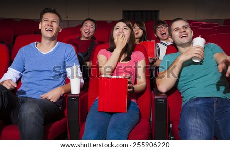 happy Young people  watching a movie at the cinema - stock photo