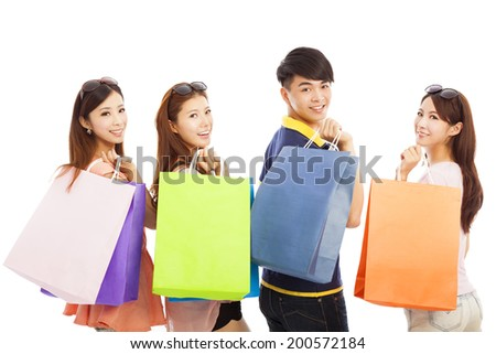 happy young people with shopping bags - stock photo
