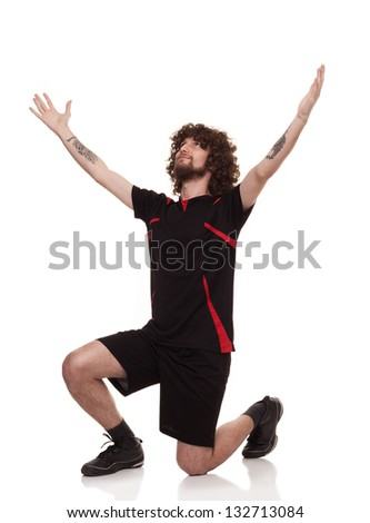happy young player celebrating the victory with his arms open isolated on white background - stock photo