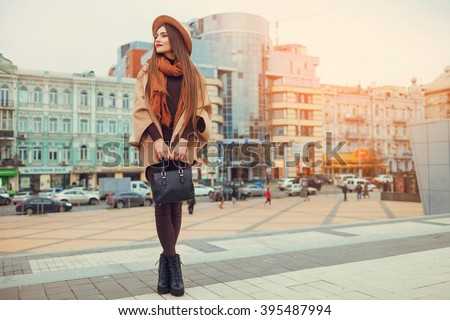 Happy young pretty woman with hat walking down the street. Vacation Europe - stock photo