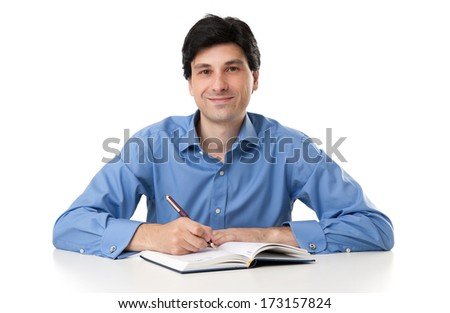 Happy Young Professional Businessman Working On Paperwork - stock photo