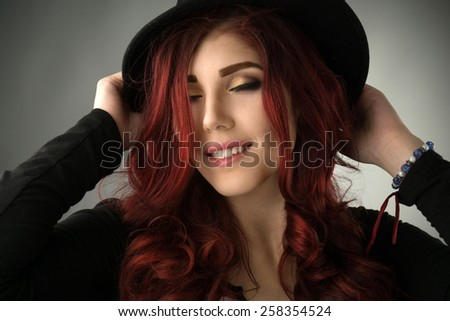 Happy young redhead woman with professional make up - stock photo