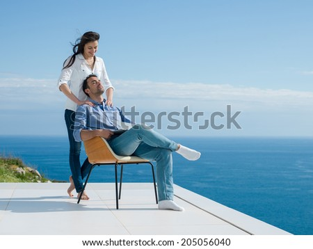 happy young romantic couple have fun relax smile at modern home indoor and outdoor