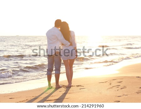 happy young romantic couple in love have fun on beautiful beach at beautiful summer day - stock photo