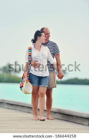 happy young romantic couple in love have fun running and relaxing on beautiful beach - stock photo