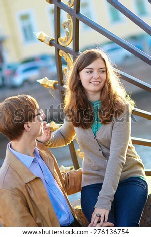 Happy young romantic couple walking together in St. Petersburg, Russia on a warm sunny autumn day in the Summer garden - stock photo
