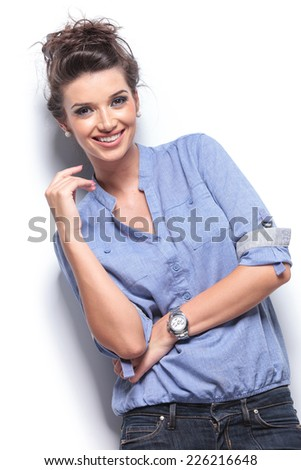 Happy young sexy woman posing for the camera while smiling, on white studio background. - stock photo