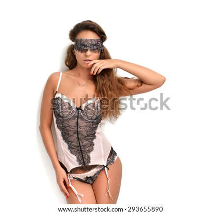 Happy young sexy woman standing in underwear and sleeping eye covering mask  isolated on a white background