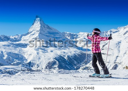 Happy young skier in mountains. Alps. Matterhorn. Swiss - stock photo