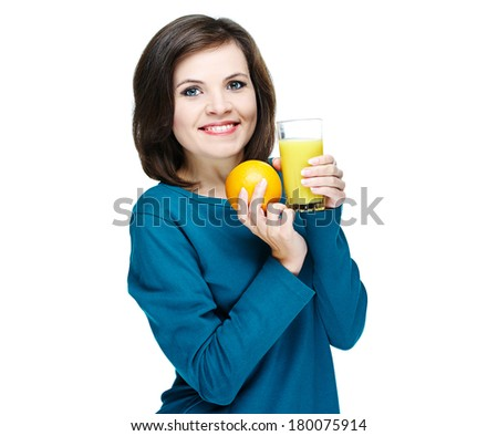 Happy young smiling girl in a blue shirt. Holding a glass of juice and orange. Isolated on white background - stock photo