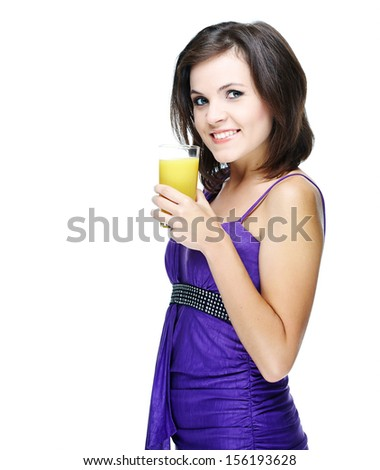 Happy young smiling girl in the violet dress. Holding a glass of juice. Isolated on white background