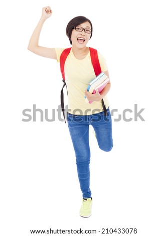 happy young student girl raising a hand with book - stock photo