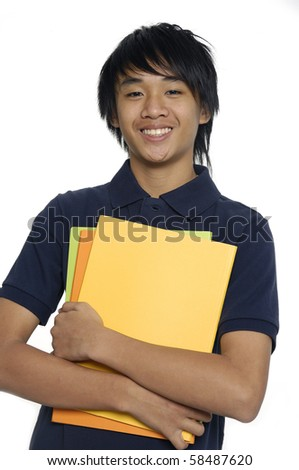 Happy young student standing with books and notes isolated