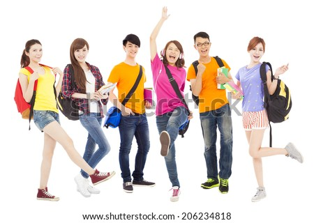 happy young students standing together with white background - stock photo
