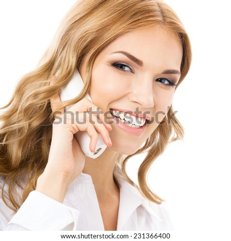 Happy young support phone operator or businesswoman with office phone, isolated against white background
