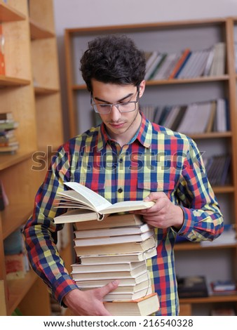 happy young teen boy in school on chemistry classes and library - stock photo