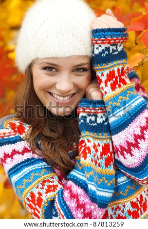 happy young teen girl in autumn scenery