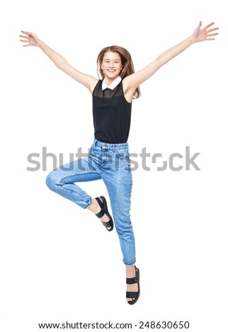 Happy young teenager girl jumping isolated on white background - stock photo