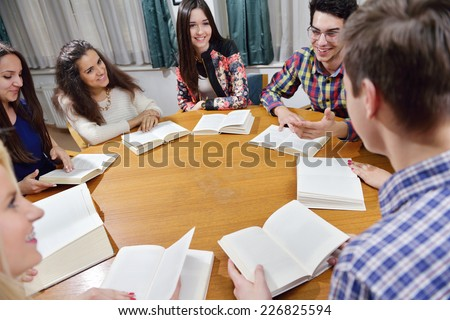 happy young teens group in school have fun an learning lessons - stock photo