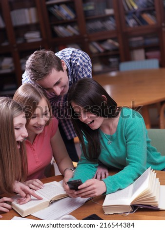 happy young teens group in school on chemisty lessons and library education