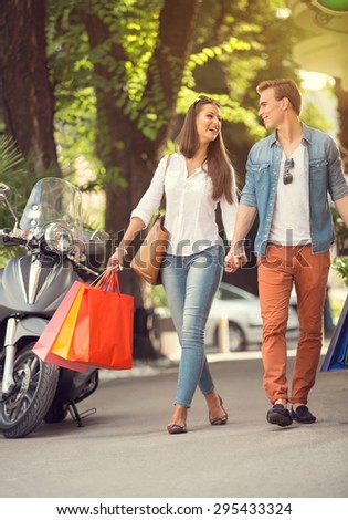 Happy young tourists couple  in shopping tour - stock photo