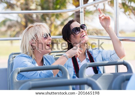 happy young tourists on a city tour bus - stock photo