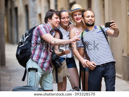 Happy young travelers doing selfie in the sightseeing tour. Selective focus - stock photo