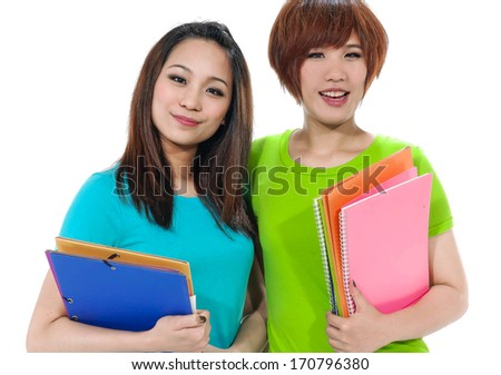 Happy young two asian student carrying notebooks  - stock photo