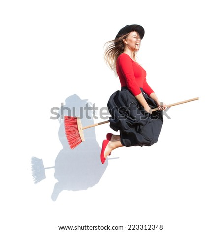 Happy young witch flying on a broom, halloween concept - stock photo