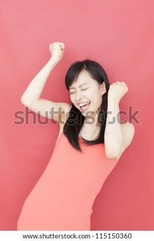 happy young woman against red background - stock photo