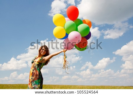 Happy young woman and colorful balloons - stock photo