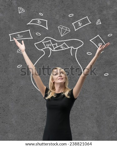 happy young woman and drawing money bag on wall - stock photo