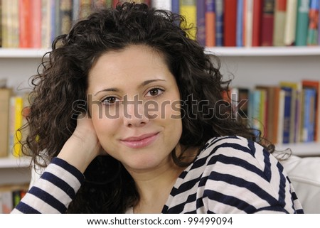 happy young woman at home smiling - stock photo