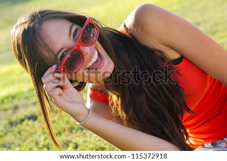 happy young woman at the park - stock photo