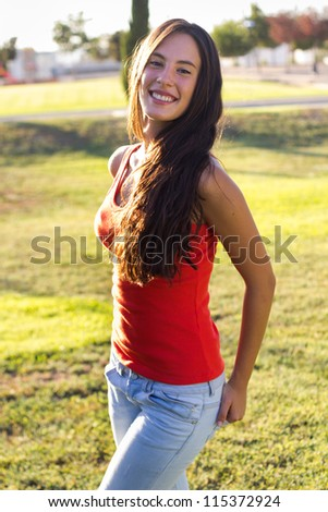 happy young woman at the park