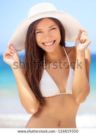 Happy young woman beach portrait. Pretty beauty face of woman in bikini relaxing outside, spa, travel and vacation concept. Mixed race Asian Chinese / Caucasian girl - stock photo